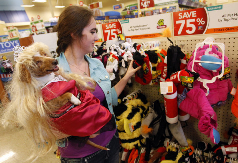 Rainbow, a miniature dachshund, and her pet parent Teresa Tubbs shop for another costume during the  ...