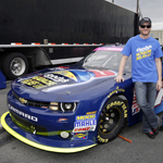 Charlotte, N.C. (Oct. 11, 2013)--NASCAR drivers Dale Earnhardt Jr. and Regan Smith of JR Motorsports unveil the Goody's Headache Relief Shot car that Smith will drive in the Dollar General 300 race tonight at Charlotte Motor Speedway. Goody's is a sponsor of Earnhardt's JR Motorsports team, and Dale Earnhardt Jr. is a spokesperson for the Goody's Headache Relief Shot, which provides fast-acting pain relief in a single liquid shot. (Photo: Business Wire)