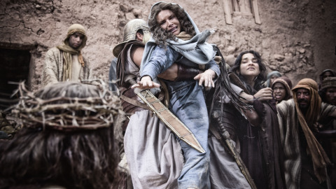 Mary (Roma Downey) struggles with a centurion. (Photo credit: Casey Crafford.)