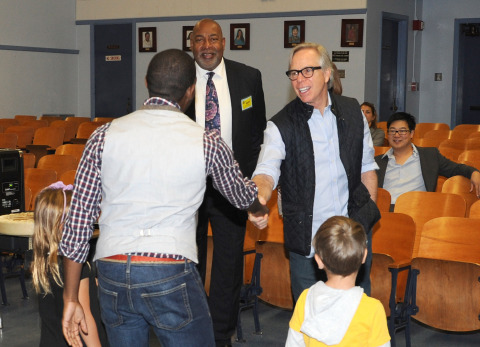 Tommy Hilfiger and President of the Tommy Hilfiger Corporate Foundation Guy Vickers meet Walgrove Elementary teacher Mr. Donzell Lewis (Photo: Business Wire)