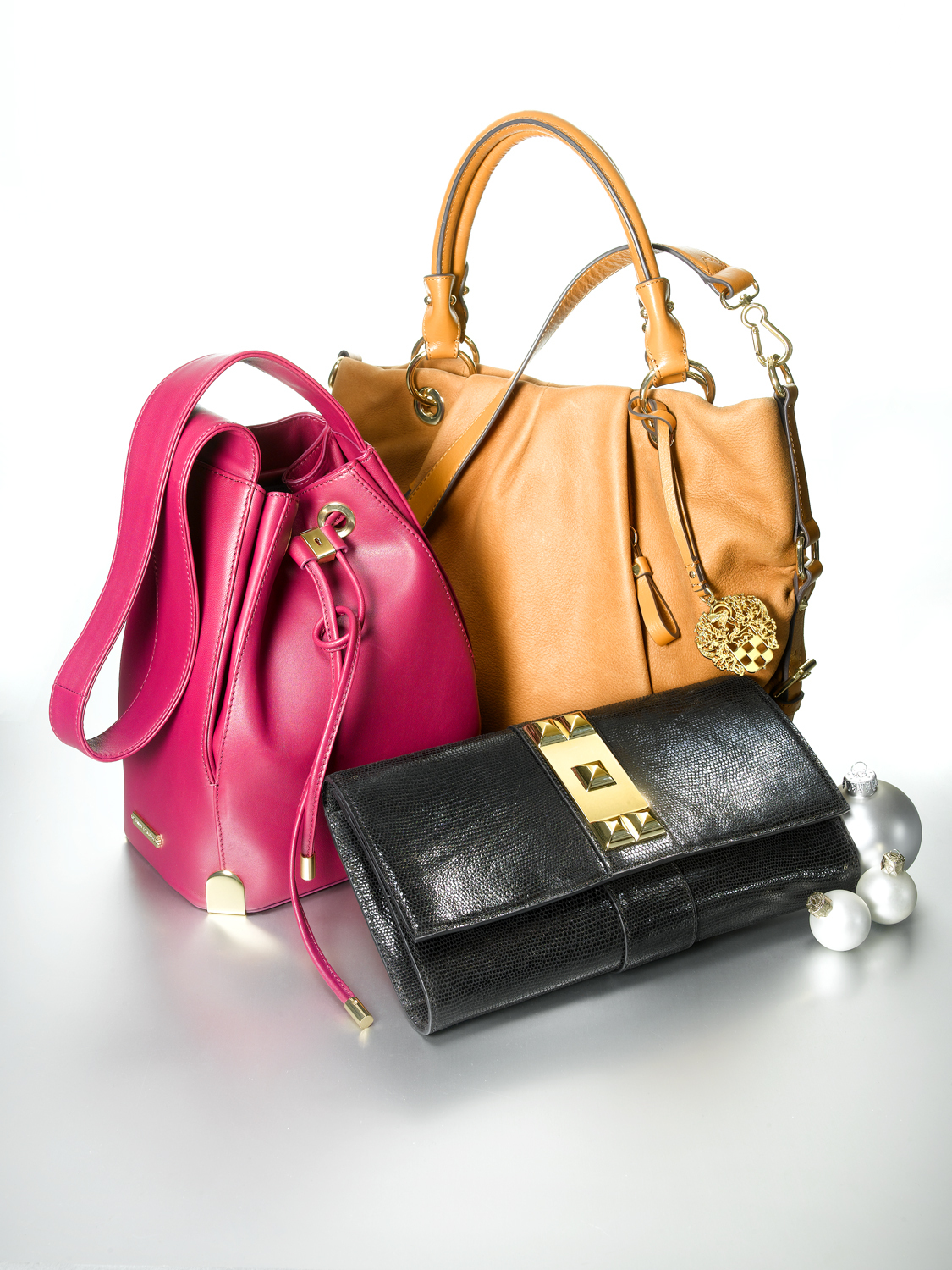 Vince Camuto Satchel $248, Drawstring Bag $178 and Clutch $148, available at select Macy's (Photo: Business Wire)