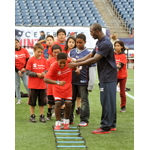 "New England Patriots Defensive Back Devin McCourty teams up with local kids to call the play for eating right and staying fit at Stop & Shop's ""Healthy Kids Summit"" at Gillette Stadium in Foxboro, Mass., October 22. The summit was an inspirational and fun-packed timeout to teach families how to make small, easy changes to live a healthier lifestyle. (Photo: Business Wire)"