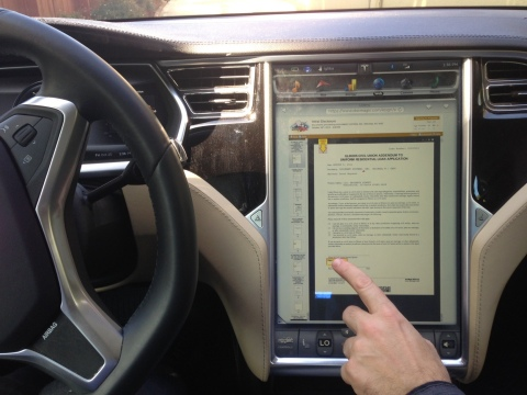 A user eSigns a 4506-T in a moving Tesla. (Photo: Business Wire)