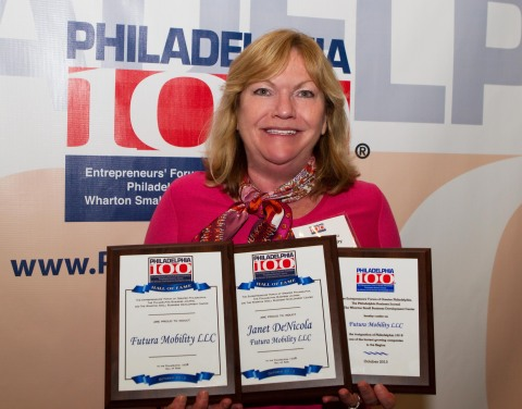 Janet DeNicola, Owner of Futura Mobility, shows off her winning plaques from the 2013 Philadelphia 100. (Photo: Business Wire)