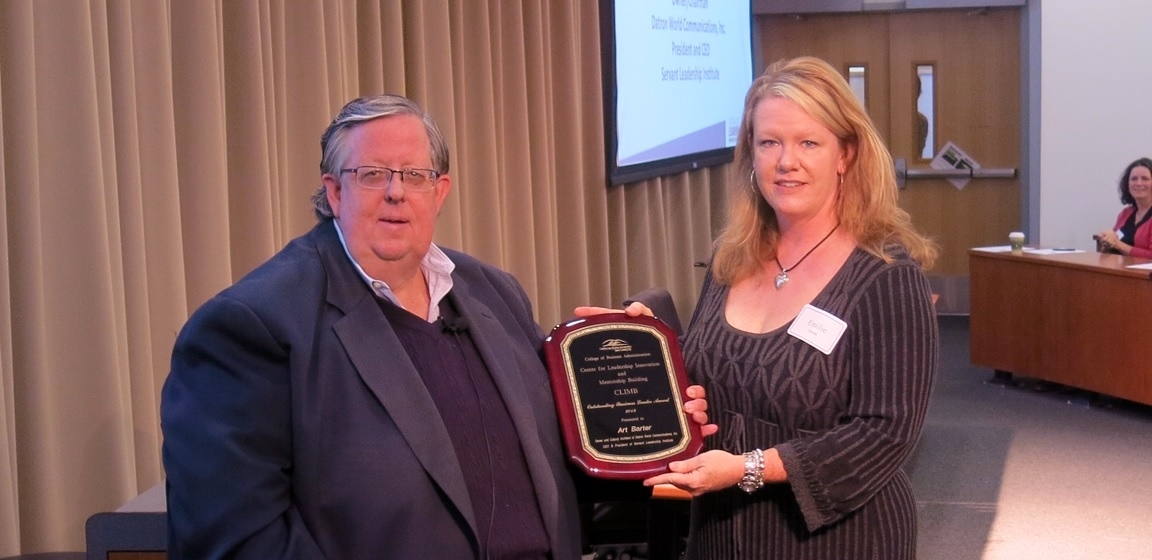 Art Barter receiving Leadership Award from Emilie Hersh, last year's award recipient. (Photo: Business Wire)