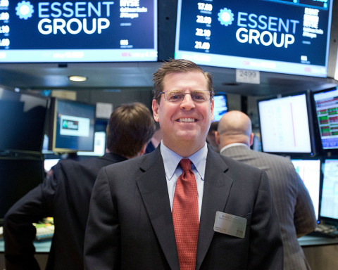 Essent Group Founder and Chief Executive Officer Mark A. Casale in the center of the trading crowd a ...