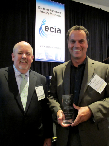 Mouser Electronics' Vice President Kevin Hess (right) accepts the ECIA 2013 Community Activism Award ...