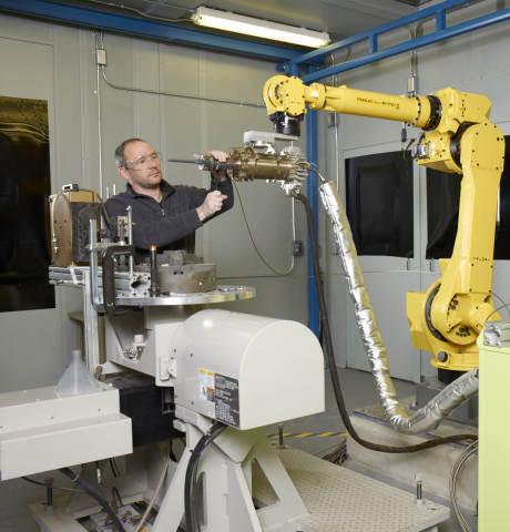 """GE researchers are developing new ways to repair and even build up parts using a process called cold spray, or as we call it, """"3D Painting."""" Metal powders are sprayed at supersonic speeds to build up and make parts. Here, GE materials engineer Leo Ajdelsztajn is in one of GE's spray booths preparing a test. (Photo: Business Wire)"""