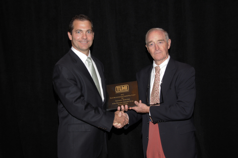 Darrell Hughes, vice president and general manager for Materials Group North America, receives TLMI' ...