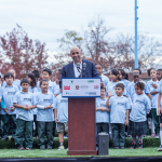 UAE Ambassador Yousef Al Otaiba accompanied by DC Mayor Vincent Gray (right) dedicates new soccer field to kids at the Marie Reed Elementary School in Adams-Morgan. (Photo: Business Wire)