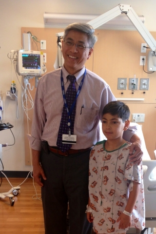 Children's Hospital Los Angeles pediatric interventional cardiologist Frank Ing, MD, with patient Br ...