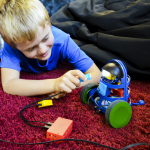 ATOMS are smart building blocks that help kids build beyond their imagination. ATOMS come in kits - like Bunsen here - and individually. (Photo: Business Wire)