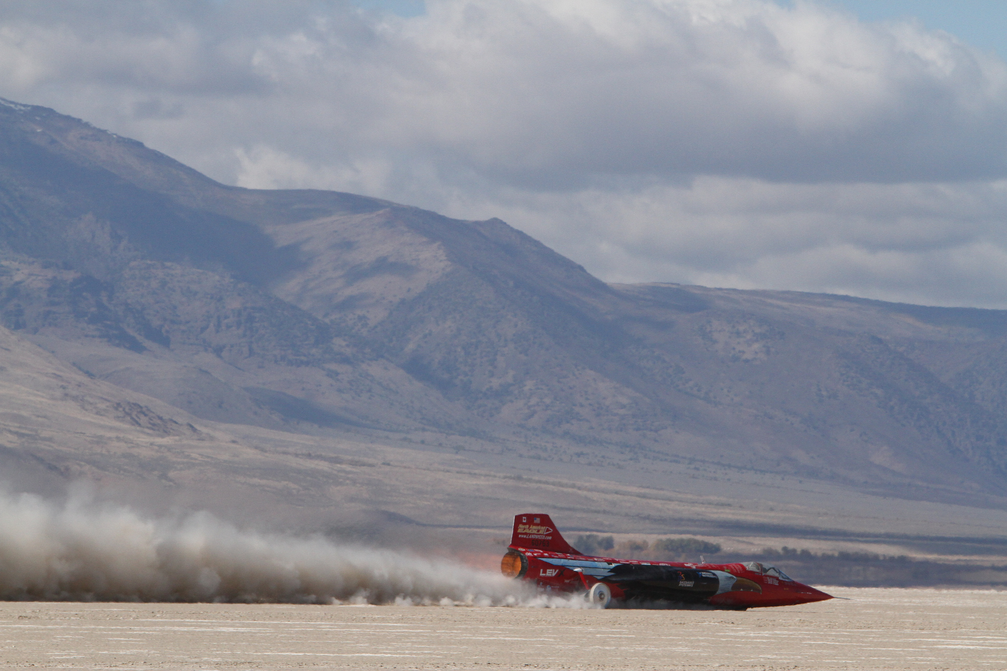 Jessi Combs recently broke the landspeed record for a woman while driving the North American Eagle Supersonic Speed Challenger, shown here at 515 miles per hour. Use of Dassault Systemes' 3DEXPERIENCE platform helps North American Eagle team members simulate and analyze fuels, lubricants and materials to understand their impact on vehicle performance and help the team stay ahead of their British counterparts in the pursuit of major land speed records. North American Eagle will speak today at Dassault Systemes' 3DEXPERIENCE Customer FORUM event in Las Vegas. Follow NAE's presentation on twitter #3DXforum (Photo: Business Wire)
