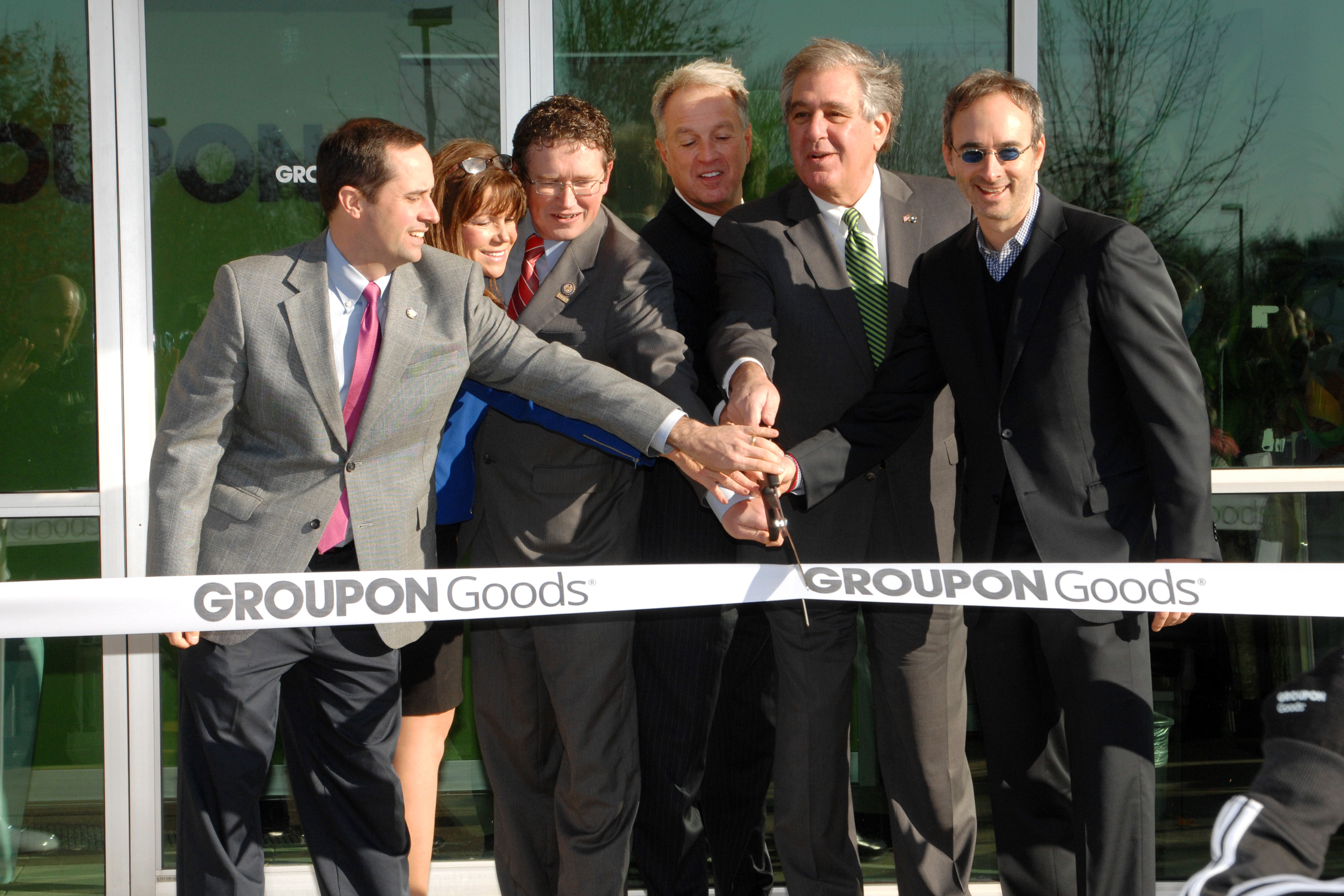 (Left to Right) Kentucky State Senator Chris McDaniel, Kentucky State Representative Addia Wuchner, U.S. Representative Thomas Massie, Judge-Executive Gary Moore, Kentucky Lieutenant Governor Jerry Abramson and Groupon CEO Eric Lefkofsky at the ribbon-cutting ceremony for Groupon's new warehouse, the Groupon Goods Fulfillment Center, in Hebron, Ky. Nov. 18, 2013. Photo by Rick Lucas.