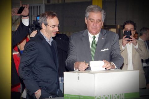 Groupon CEO Eric Lefkofsky (left) and Kentucky Lieutenant Governor Jerry Abramson sign a card for the recipient of the first package being sent from the new Groupon Goods Fulfillment Center in Hebron, Ky. today. The two also took part in the ribbon-cutting ceremony at the fulfillment center, Groupon's first warehouse. Nov. 18, 2013. Photo by Rick Lucas.