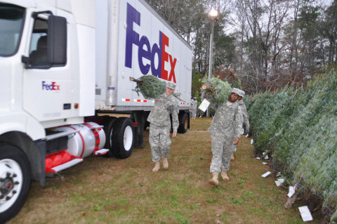 FedEx employees will help deliver more than 17,000 Christmas trees to military bases throughout the  ...