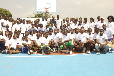 Over 50 Students from several high schools in Abuja, Nigeria participated at the launch ceremony of the Power Forward program sponsored by ExxonMobil, NBA/WNBA and Africare. Picture shows the students at the launch event with  Nigeria's Minister of Finance, Dr. Ngozi Okonjo-Iweala; NBA Hall of Famer, Hakeem Olajuwon; former NBA player, Obinna Ekezie; WNBA All Star, Swin Cash and executives from the 3 partner organizations. (Photo: Business Wire)