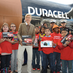 "Ellen DeGeneres, Toys for Tots Marines, and local children celebrate the launch of the Duracell ""Power a Smile"" program that will donate up to 1 million batteries to Toys for Tots, triggered by the purchase of eligible Duracell battery packs, on Friday, Nov. 22, 2013 in Los Angeles. (Photo by John Shearer/Invision for Duracell/AP Images)"