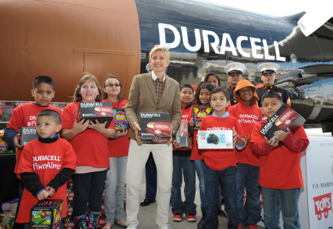 """Ellen DeGeneres, Toys for Tots Marines, and local children celebrate the launch of the Duracell """"Power a Smile"""" program that will donate up to 1 million batteries to Toys for Tots, triggered by the purchase of eligible Duracell battery packs, on Friday, Nov. 22, 2013 in Los Angeles. (Photo by John Shearer/Invision for Duracell/AP Images)"""
