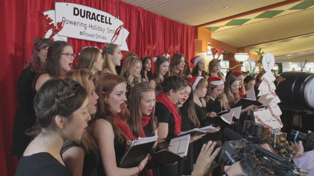 Duracell Holiday Launch Hilary Duff carolling at SickKids with choir