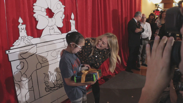 Duracell Holiday Launch Hilary Duff handing out toys