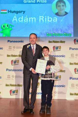 Eco Picture Diary Grand Prix winner receiving the trophy from Chairman and CEO of Panasonic Europe,  ...