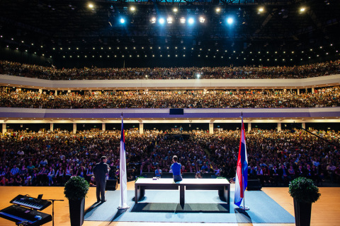 Evangelist Nick Vujicic speaks to a crowd of thousands during a visit to Paraguay in October 2013 as ...