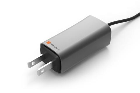 FINsix's miniature 65 watt laptop adapter. (Photo: Business Wire)