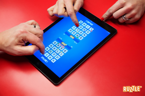 Ruzzle for iPad features simultaneous face to face competitive play on a single iPad for the ultimat ...