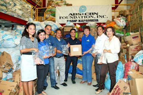 PAMASKONG PATUBIG - Photo shows PCPPI's Senior Manager Rondell Torres handing over a box of potable  ...