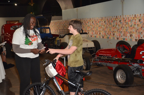 Lucky boy getting his new bike at the Foster Santa event. (Photo: Business Wire)