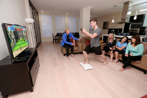 "In this photo provided by Nintendo of America, TJ Smith from Los Angeles plays Wii Fit U's ""Hosedown,"" one of several new activities in the game that use the Wii U GamePad controller. Prior to the game's retail launch on Jan. 10, a few select Nintendo fans had the opportunity to participate in Nintendo's ""Wii Fit U Challenge,"" which encourages Wii U owners and families to incorporate the game into their busy schedules as a fun and convenient way to stay active throughout the year. (Photo: Business Wire)"