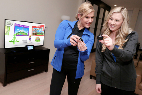 "In this photo provided by Nintendo of America, celebrity trainer and fitness expert Kathy Kaehler compares Fit Meter data with Katie Wilson from Los Angeles while playing Wii Fit U on the Wii U console. In support of the game's Jan. 10 retail launch, Nintendo is partnering with Kaehler to kick off the ""Wii Fit U Challenge,"" which encourages Wii U owners to use the game as a fun way to stay active throughout the year. The portable Fit Meter is designed to sync up with the game and track daily activities on the go. (Photo: Business Wire)"