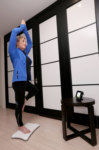 In this photo provided by Nintendo of America, celebrity trainer and fitness expert Kathy Kaehler strikes a yoga tree pose in Wii Fit U, one of the off-TV activities in the game that only requires the Balance Board and GamePad. Wii Fit U uses the second screen of the Wii U GamePad controller, which means select activities like yoga and strength exercises can continue on the GamePad, even if someone else wants to tune into their favorite show using the same TV. With more than 70 activities and exercises to choose from, including 19 new activities, there's something for everyone in Wii Fit U, available in stores on Jan. 10. (Photo: Business Wire)