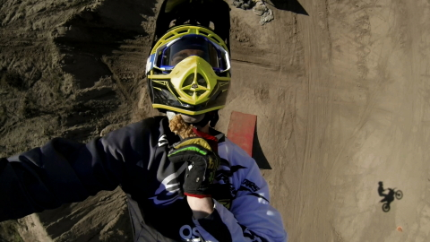 X Games gold medalist Bryce Hudson backflips on a motorcycle while eating KFC. This video is one of  ...
