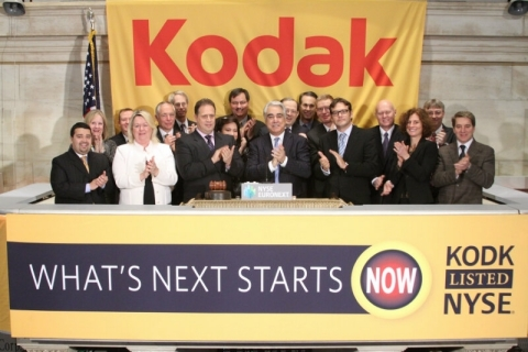 Kodak President and CEO Antonio M. Perez (4th from right) rings the opening bell to celebrate Kodak's return to NYSE. Perez is joined on the podium by Kodak Chairman of the Board James V. Continenza (left of Perez