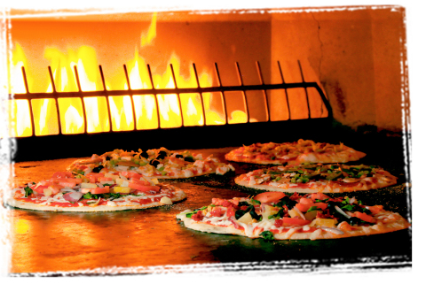 "PizzaRev's ""Craft Your Own"" pizza uses a 900° open-flame stone-bed oven. (Photo: Business Wire)"