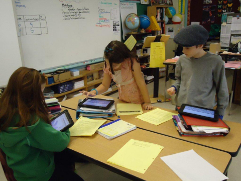 Students at Oyster River Cooperative School District use a mix of personal and school-issued mobile  ...