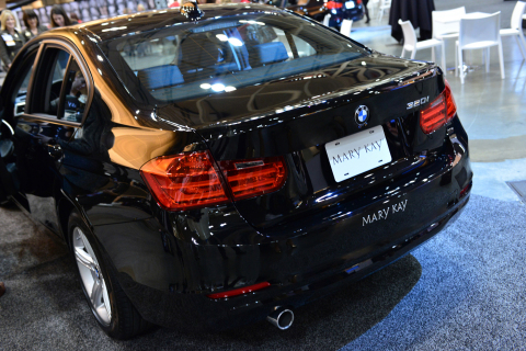 More than ten thousand women went from speechless to on their feet roaring with cheers of approval as Mary Kay unveiled the new BMW 320i as an addition to its beauty fleet. The announcement is one of the biggest and loudest in Mary Kay's 50 year history and took Independent Beauty Consultants by surprise at the Company's annual Leadership Conference held in New Orleans.  The sleek BMW 320i joins the iconic Mary Kay pink Cadillac and the fleet of Mary Kay Career Car options available to top-performing, qualifying Mary Kay Independent Sales Directors. The career cars continue to serve as a symbol of status and achievement within the Mary Kay independent sales force. (Photo: Business Wire)