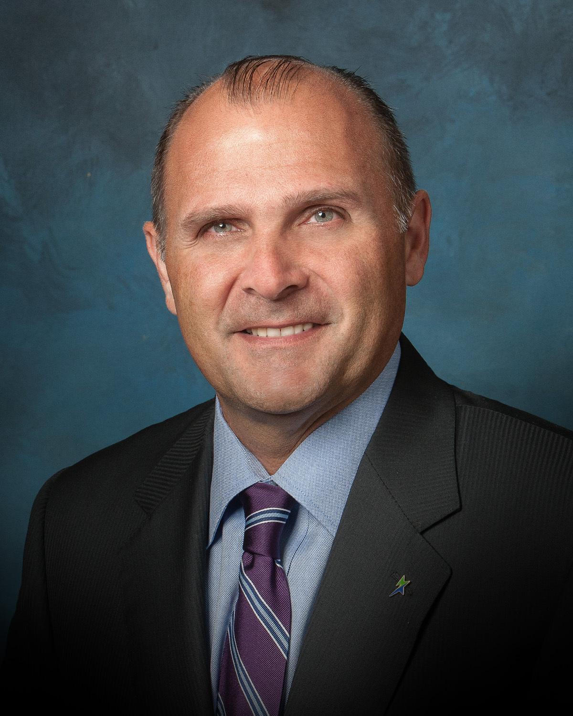 Michael W. Harrington (Photo: Business Wire)