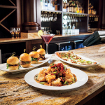 "BRAVO! Hours feature nine scrumptious ""plate"" selections, perfect for sharing. Offered in tiered pricing from $4–$6 are dishes including the new Beef Carpaccio, the new Pulled Pork Sliders, and full appetizer portion Crispy Shrimp Napoli. (Photo: Business Wire)"