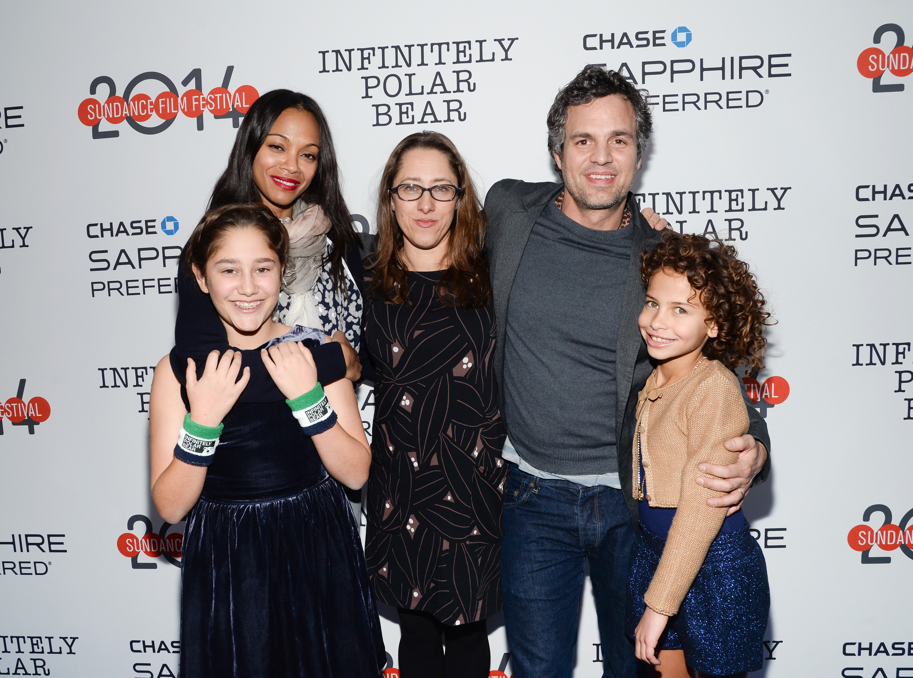 """Director Maya Forbes, center, poses with cast members, from, left, Imogene Wolodarsky, Zoe Saldana, Mark Ruffalo and Ashley Aufderheide at the """"Infinitely Polar Bear"""" premiere party hosted by Chase Sapphire Preferred during the Sundance Film Festival on Saturday, Jan. 18, 2014 in Park City, Utah. (Photo by Evan Agostini/Invision for Chase Sapphire Preferred/AP Images)"""