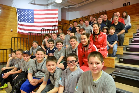 Youth from the Town of Poughkeepsie's Babe Ruth League - Cal Ripken Division attended a Marist College basketball game in celebration of the United Water and Cal Ripken, Sr. Foundation Badges for Baseball program. Representatives from United Water and Town Supervisor Todd Tancredi played in the children's Quickball tournament as part of the celebration. (Photo: Business Wire)