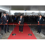 Emmen Mayor Cees Bijl, Menicon CEO Hidenari Tanaka and Japanese diplomat Yutaka Kikuta cut the ceremonial ribbon to open Menicon's new facility at Emmen, the Netherlands. (Photo: Business Wire)