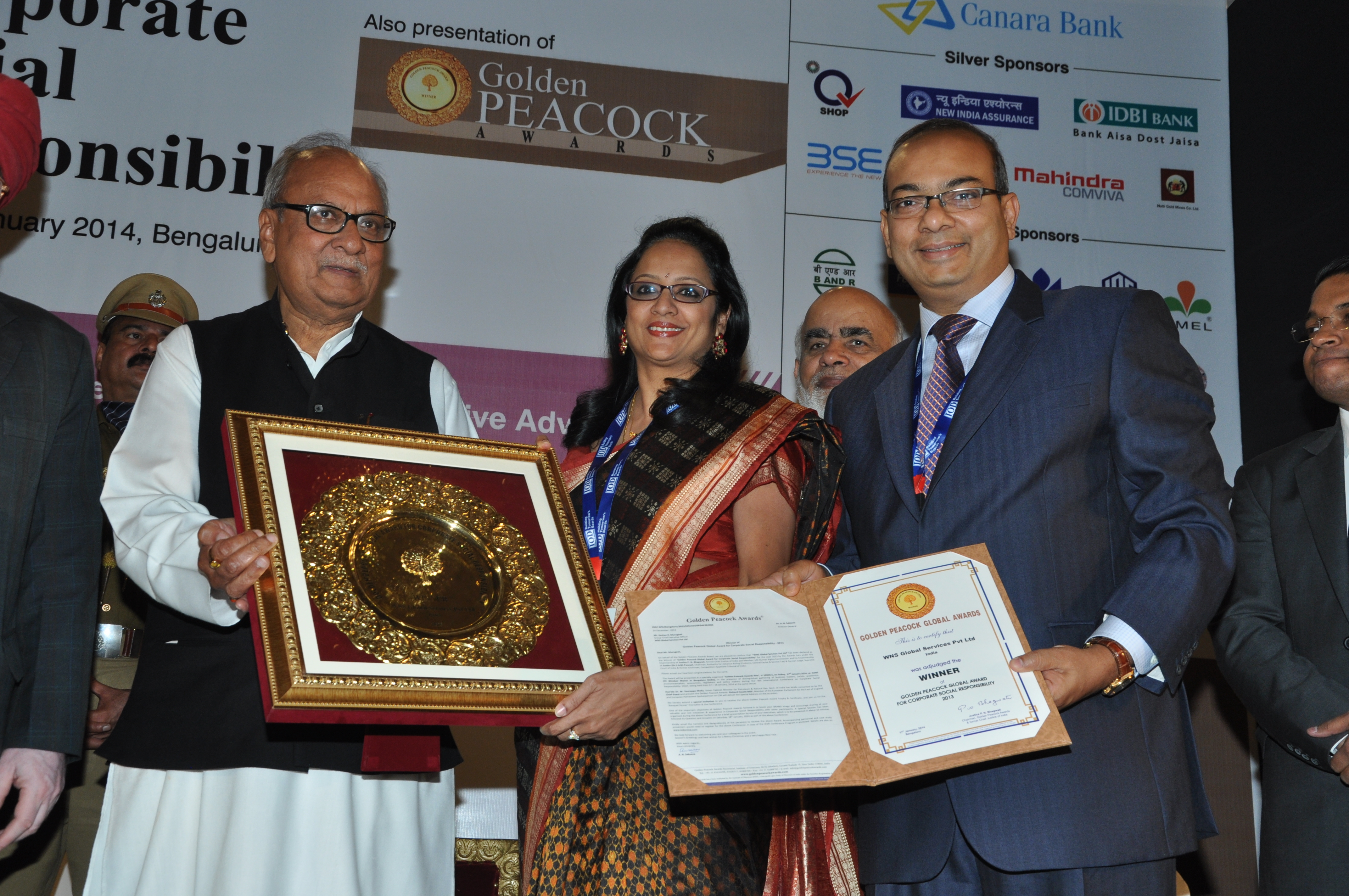 His Excellency Nikhil Kumar, Hon'ble Governor of Kerala giving the award to Keshav R. Murugesh, Group CEO WNS, and Shamini R. Murugesh, Honorary Chief Mentor WNS Cares Foundation at the 8th International Conference on Corporate Social Responsibility held at Hotel ITC Windsor Manor in Bengaluru, India (Photo: Business Wire)
