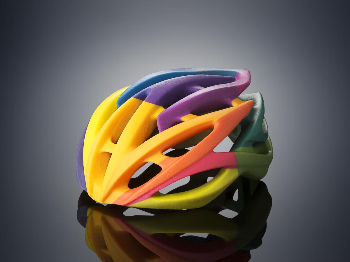 Bike helmet 3D printed on the Objet500 Connex3 Color Multi-material 3D Printer in one print job using VeroCyan, VeroMagenta, and VeroYellow (Photo: Stratasys Ltd.)