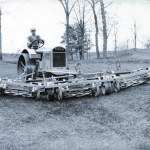 Mounting five lawn mowers onto the front of a farm tractor, Toro develops the Standard Golf Machine in 1919 and helps create the motorized golf course equipment industry. (Photo: Business Wire)