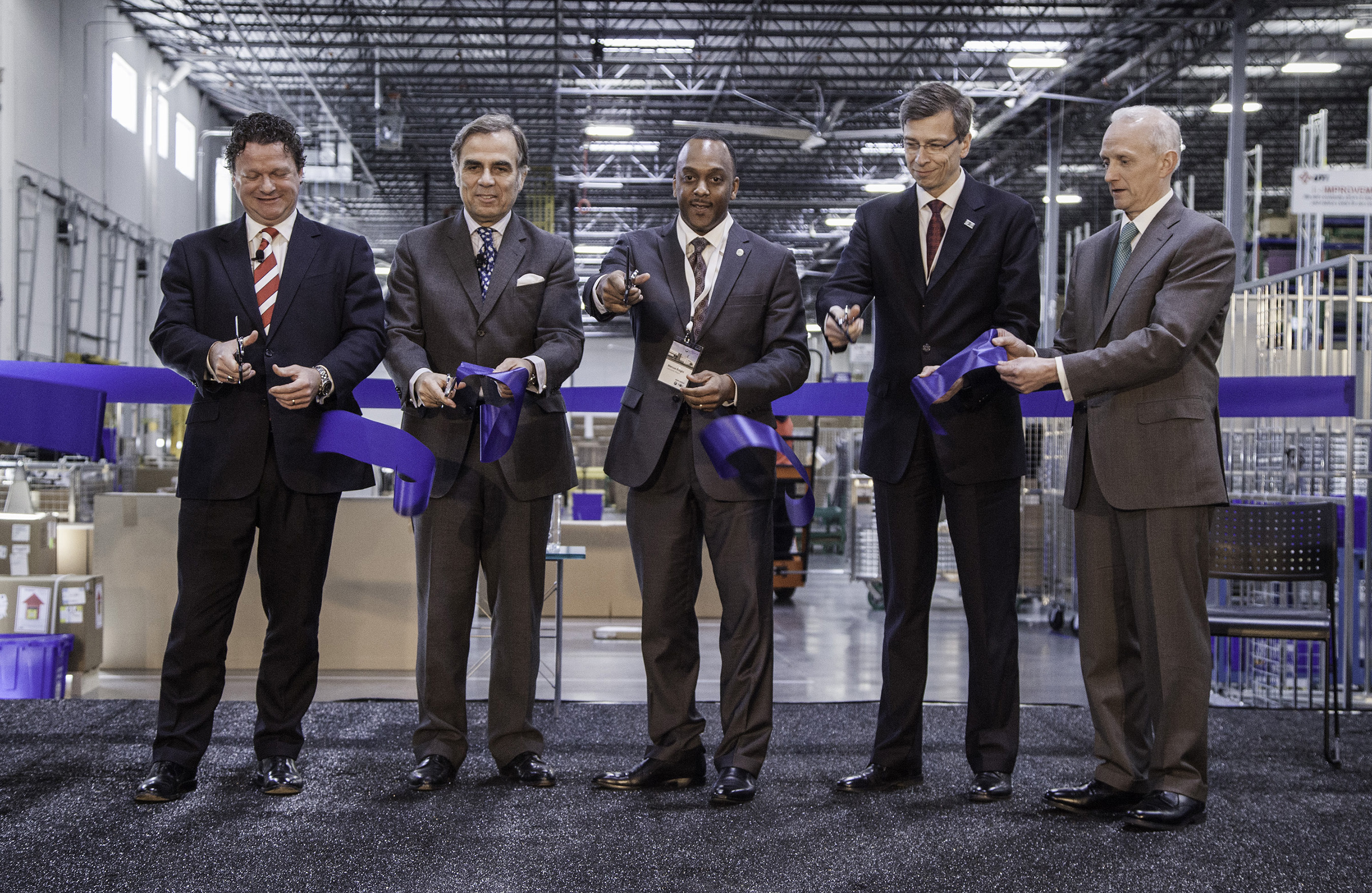 Craig Westbrook, Vice President - Aftersales, BMW of North America; Ludwig Willisch, President and CEO, BMW of North America; Marcus Knight, Mayor, Lancaster, Texas; Stefan Sengewald, Executive Vice President and CFO, BMW of the Americas and Lawrence P. Demski, Department Head, Parts Logistics, BMW of North America cut the ribbon to officially open the BMW Dallas Regional Parts Distribution Center (RDC) in Lancaster, Texas on January 27th, 2014. The fully-secured, LEED Silver certified, state-of-the art RDC will serve the Southern Region of the dealer network and will supply everything BMW dealers need to service their customers. (Photo: Business Wire)