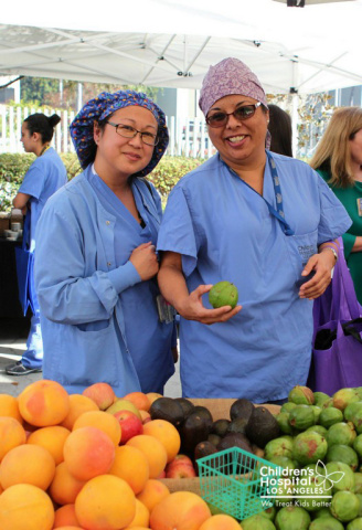 Staff attend inaugural farmer's market at Children's Hospital Los Angeles. (Photo: Business Wire)
