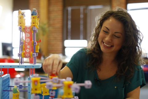 Debbie Sterling, Founder and CEO of GoldieBlox, a toy company out to inspire the next generation of female engineers, demonstrates how cool engineering can be with GoldieBlox toys, in their office in Oakland, CA. GoldieBlox is the winner of the Intuit Small Business Big Game campaign; its 30-second ad will air during the third quarter of this Sunday's football game. (AP Photo: Alison Yin)